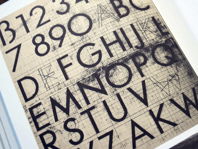 Uppercase Futura on graph paper.