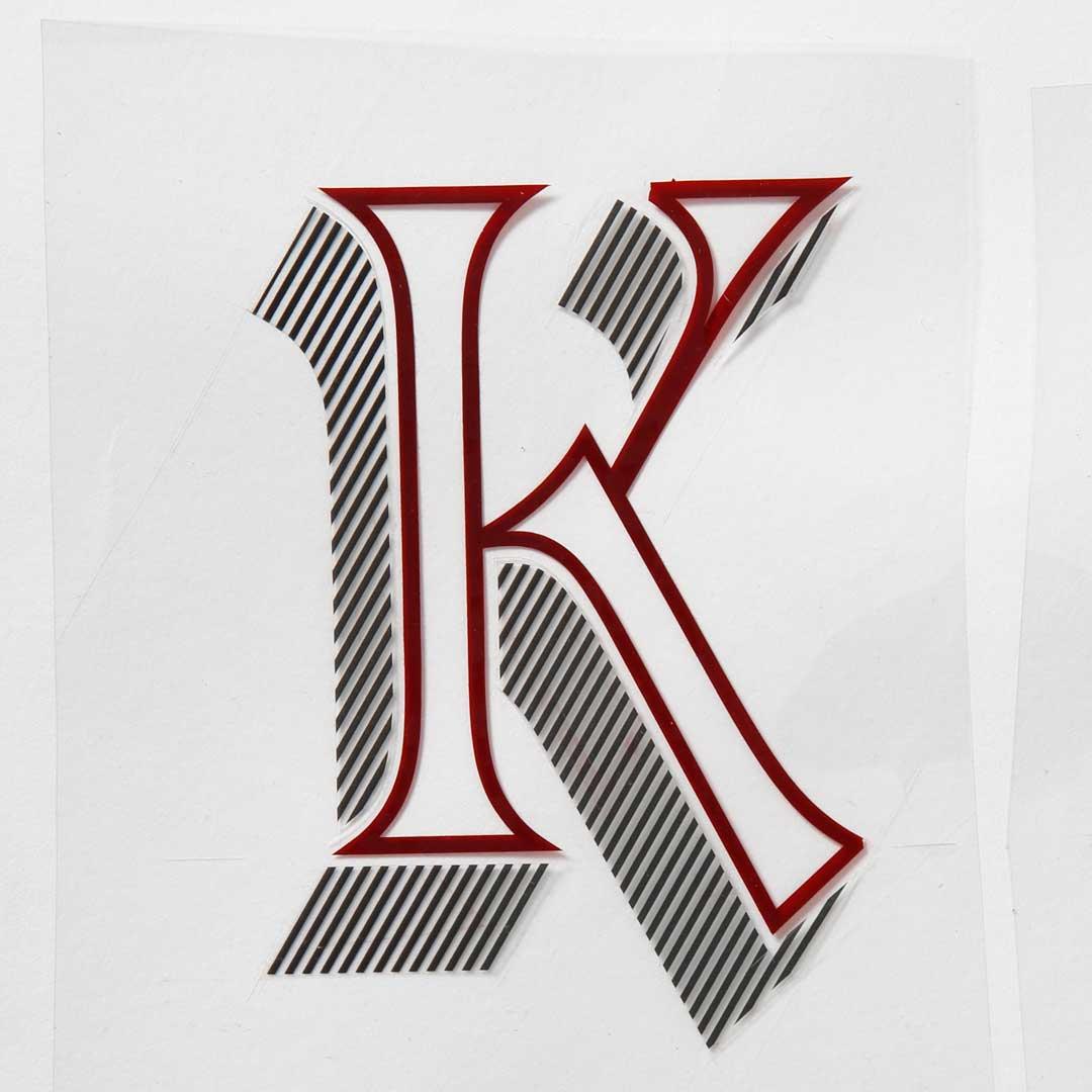 Freda's rubylith cut of Letraset Talisman capital 'K'.