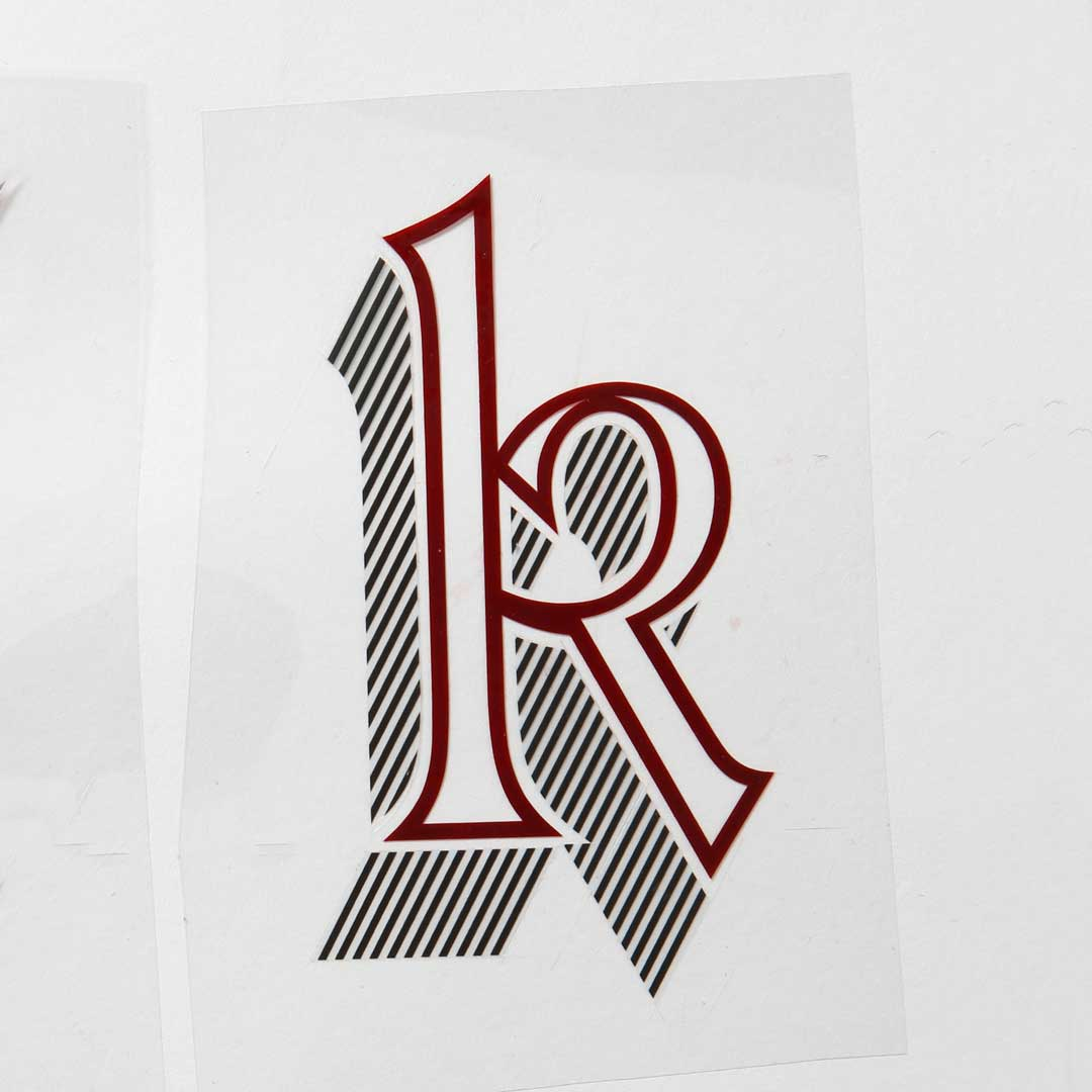 Freda's rubylith cut of Letraset Talisman lowercase 'k'.