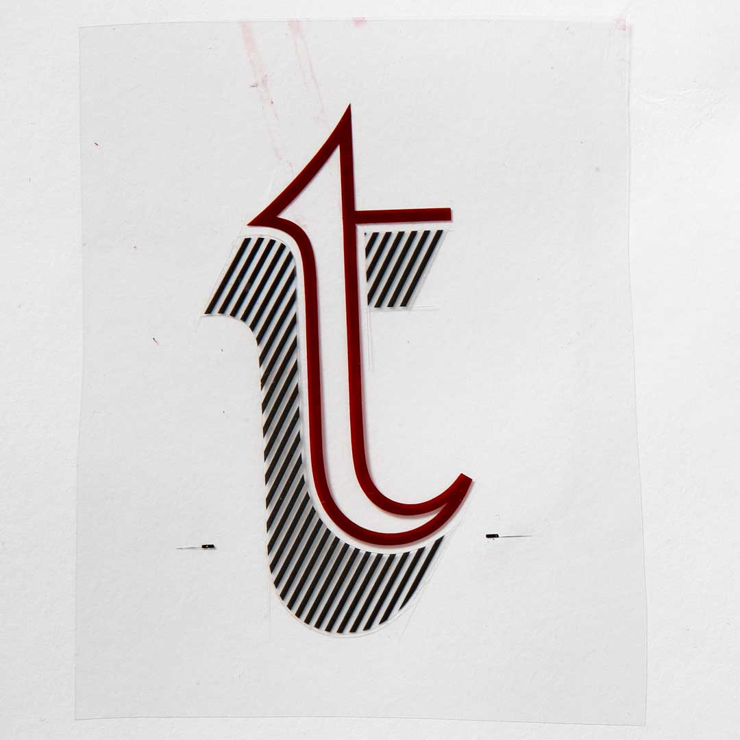 Freda's rubylith cut of Letraset Talisman lowercase 't'.