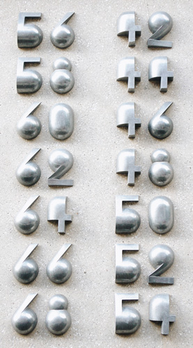 'Amsterdamse School' house numbers.